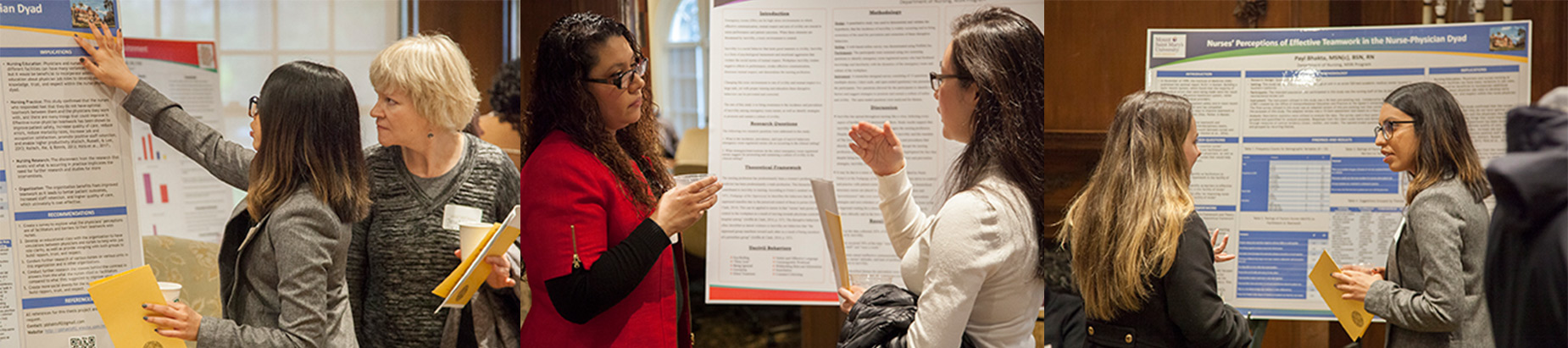 two women talking in front of project poster