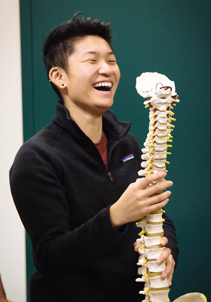 Student laughing at a bone