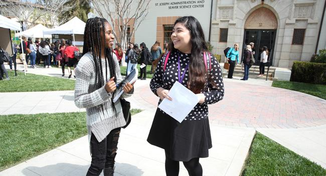 Students talk on the Admin Lawn between presentations at the Mount's 2018 Academic Symposium.