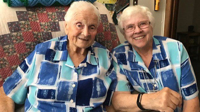 Twinning? Sister Barbara Anne CSJ, '60 (right) and Sister Catherine Irene are all smiles in their matching blouses.