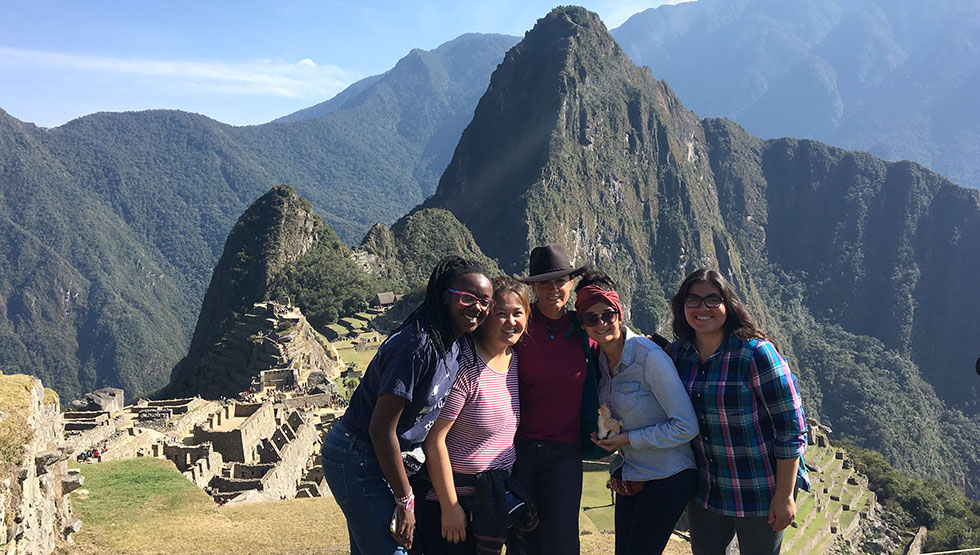 Professor Lia Roberts, PhD, center, with some of the students who traveled to Peru in August 2017 to study the country's healthcare system up close.