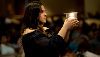 The candle lighting procession during the Laurel Awards ceremony at Doheny.