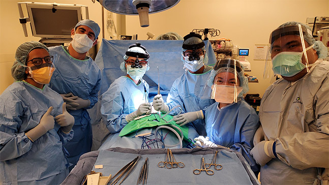 Gail Angelli Daclan '21, second from the right, in the operating room with a head and neck surgical team at UCLA through a partnership between the two universities to expose more students to perioperative nursing.