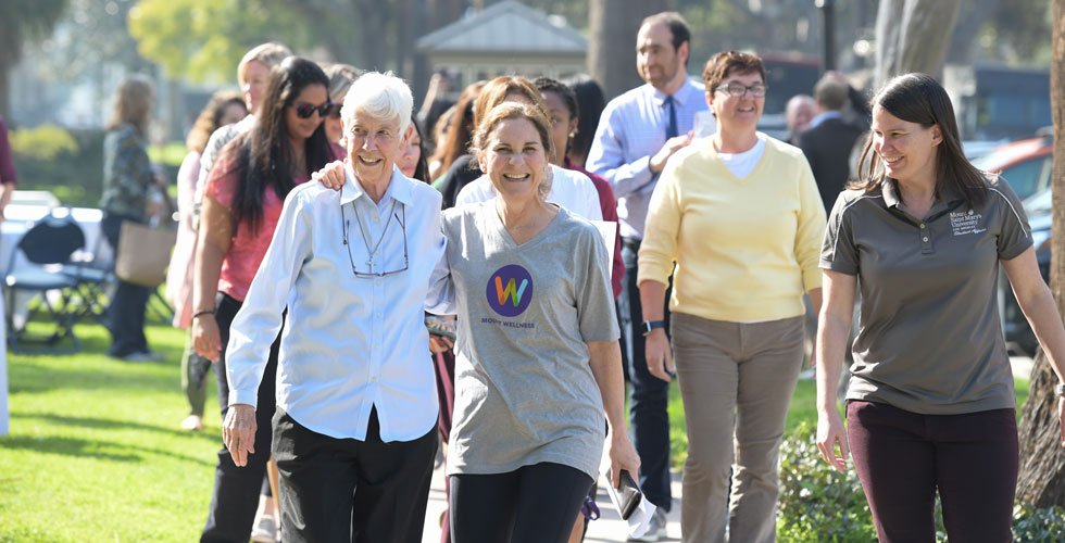 Sr. Kieran Vaughn, CSJ, President Ann McElaney-Johnson, and Autumn Johnson, director of sports and wellness, lead the inaugural Wellness Walk at the Doheny Campus on Jan. 29.