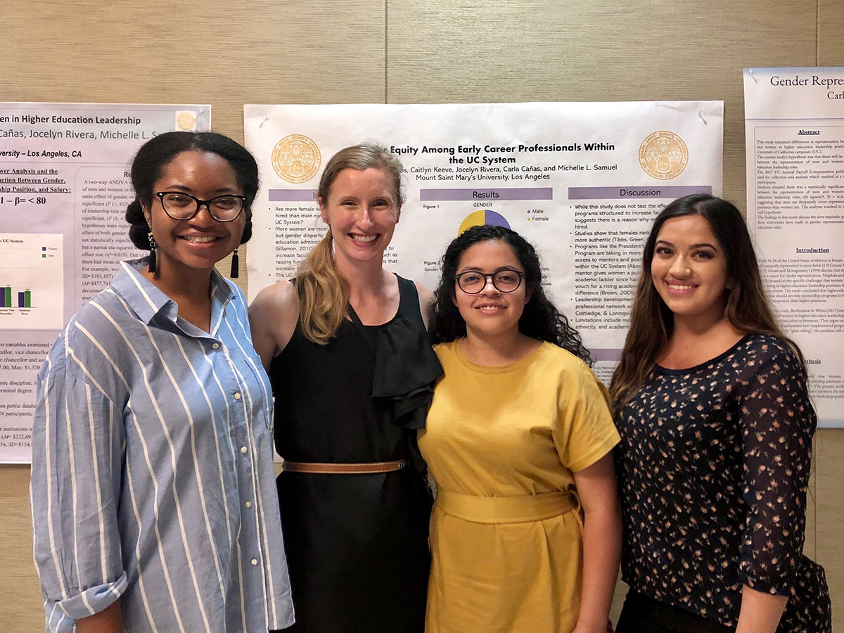 Psychology Assistant Professor Michelle Samuel (second, left) joins three of the student authors – (from left) Caitlyn Keeve, Carmen Ramos and Carla Canas – at a student psychology conference where they shared their research work.