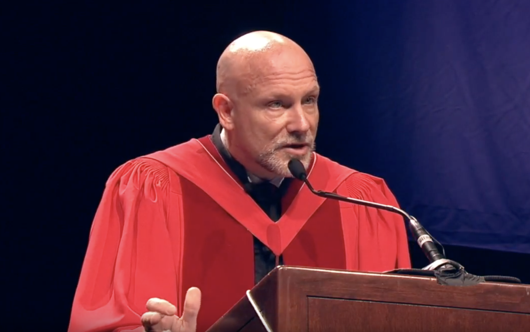 Bob Perrins delivering a commencement speech
