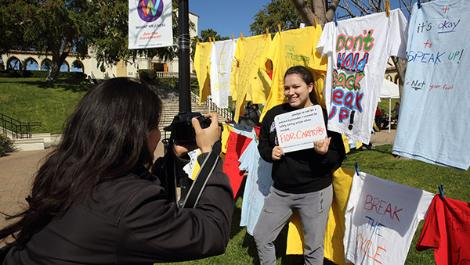 Students add a message to The Clothesline Project at Chalon Campus.