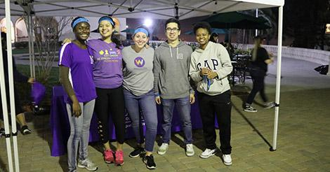 A team from one of the games of nighttime Capture the Flag on campus during Wellness Week.