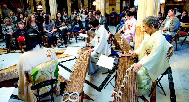 Members of the L.A. Women's Koto Ensemble play during a performance in the Doheny Mansion.