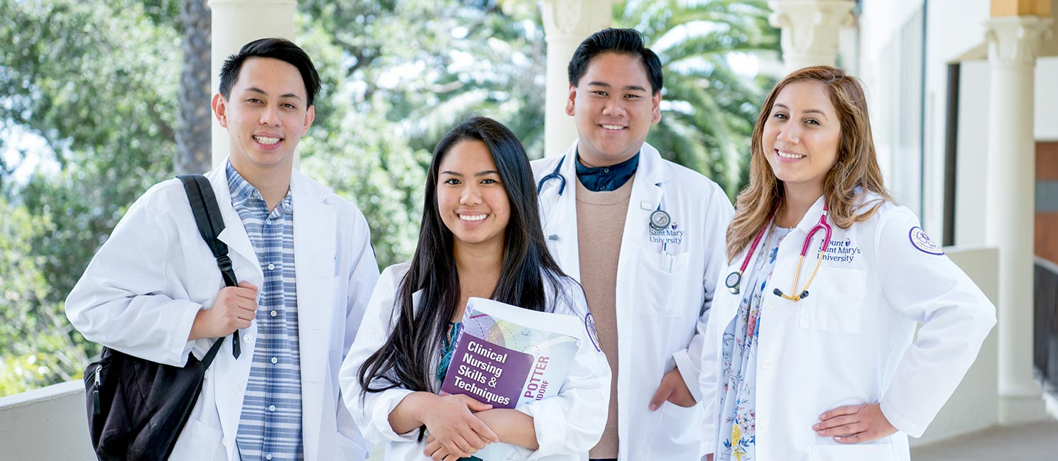 Students in nursing attire posing together